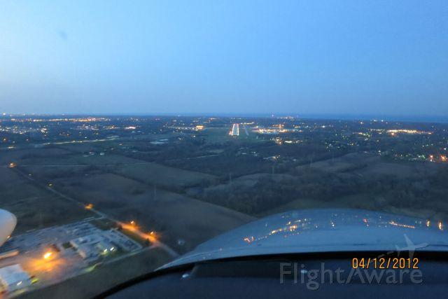 Piper PA-30 Twin Comanche (N8788Y) - Shirt final Runway 5 at KUGN at dusk
