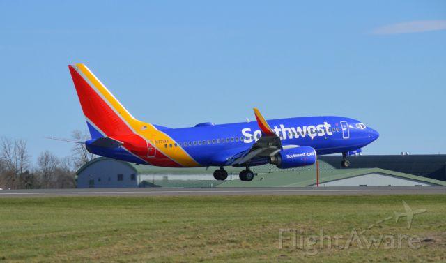Boeing 737-700 (N7719A) - Southwest 737 over the numbers on Runway 24 at Bradley Intl