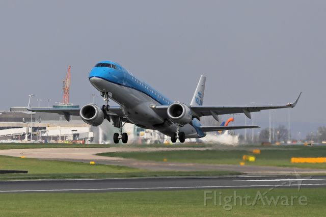 Embraer ERJ-190 (PH-EXD) - At about 1545 in mid April the sun is dead ahead when departing on 23L.  KLM1076 departs to Amsterdam.