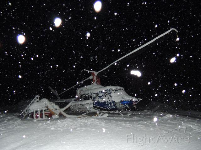 Bell VH-1 (C-GGSM) - Heli-skiing