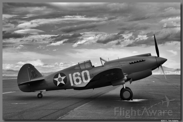 — — - Just restored P-40C owned by Rod Lewis on the ramp at Stead, NV.