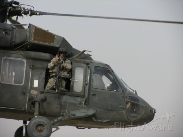 — — - Me on my last deployment, departing Baghdad on a mission.  I sure do miss these days!
