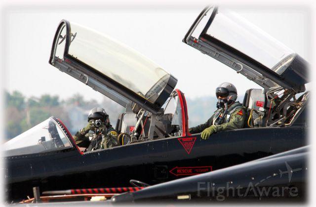 Northrop T-38 Talon — - Back at ya Mr. photo man.  Who knew digital cameras were standard issue in Recon T-38's.  These T-38's are all black... used for recurrent training for USAF pilots who fly the U2 and B2. Sitting at Huntsville, AL.  Photo copyright:  BlakeMathis.com