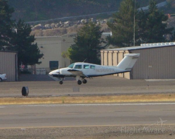 Beechcraft Duchess (N3692X) - Another trainer floating down 27R