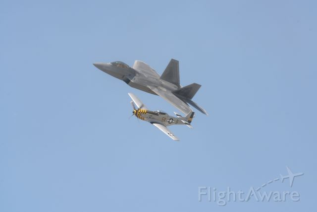 Lockheed F-22 Raptor — - F-22 Raptor in formation with P-51 Mustang at Quinte International Air Show.