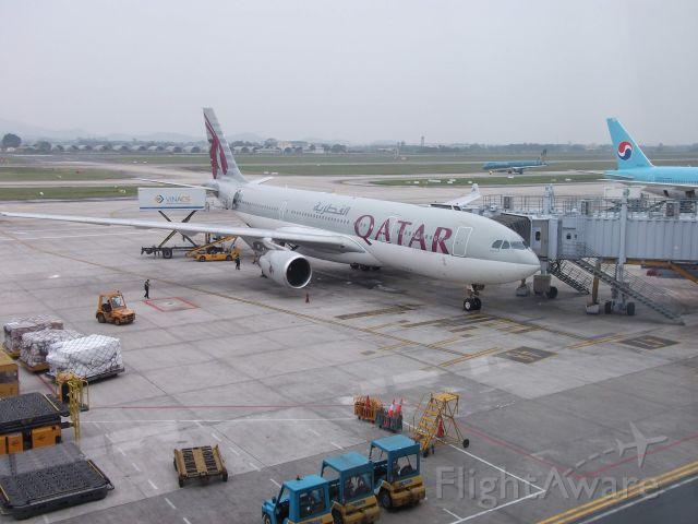 Airbus A330-200 — - A Qatar Airways A330 at it's gate at the Noi Bai International Terminal, getting prepared for a flight to Doha International Airport.
