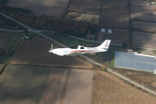 Lancair Legacy 2000 (N550BL) - Formation flight over Windsor, Ontario, Canada