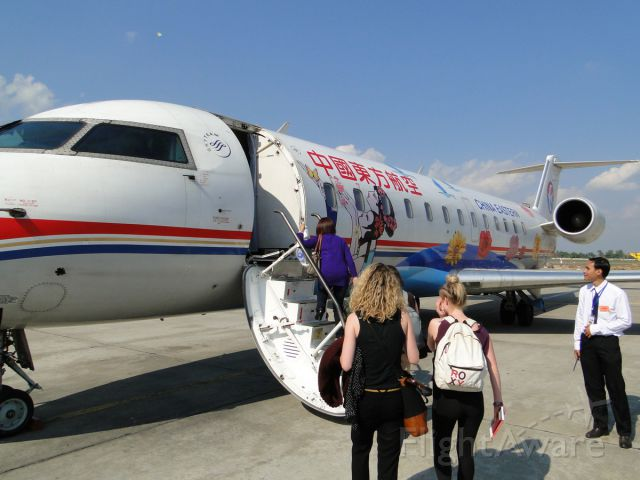B-3013 — - Sitting in Kunming, China... about to fly to Laos (Jan. 2012).  I love the paint job!