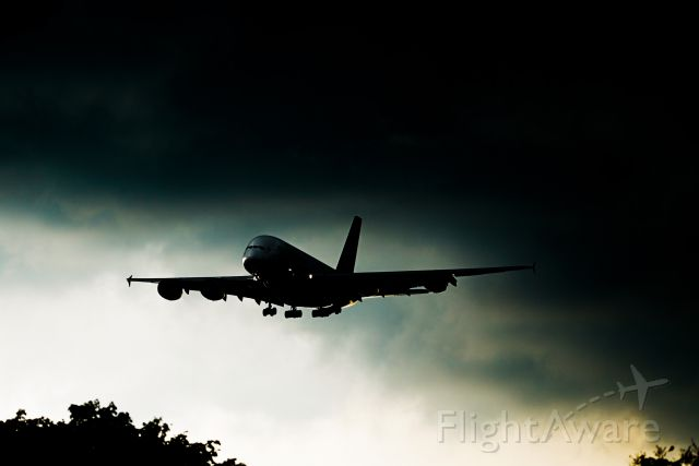 Airbus A380-800 (9V-SKK) - A380 arrives together with the rain clouds