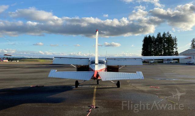 Cessna Skyhawk (N9690H) - Flaps down, doors open. Preflight in progress! Spanaflight's Cessna shortly before a local flight.
