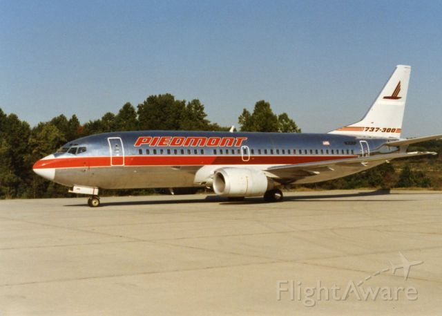 """BOEING 737-300 (N306P) - Piedmont Airlines, N306P, Boeing 737-301, msn 23258, Photo by John A. Miller, <a rel=""""nofollow"""" href=""""http://www.PhotoEnrichments.com"""">www.PhotoEnrichments.com</a>"""