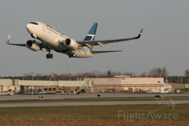 Boeing 737-700 (C-FWCC) - April 17, 2006 - departed from London Airport