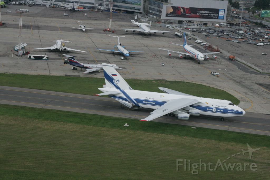 Antonov An-124 Ruslan (RA-82042) - AN-124 loading at DME in Moscow.  Some other aircraft in the background