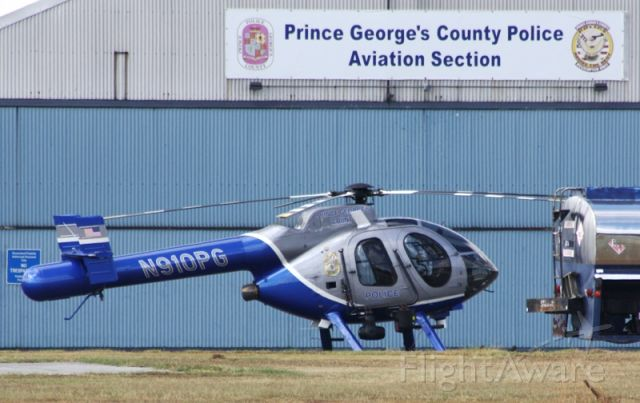MD HELICOPTERS MD-520N (N910PG) - Prince George's County PD's helicopter, Guardian, parked outside its hangar at College Park Airport.
