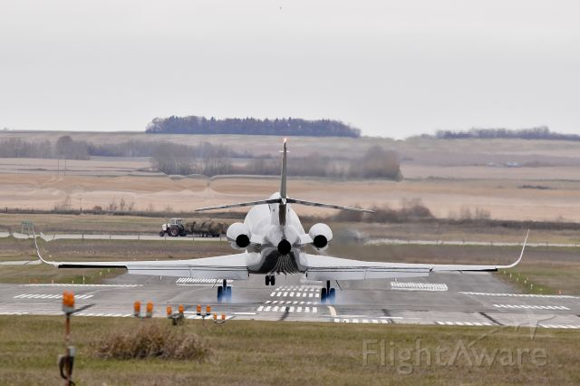 Dassault Falcon 900 (N504ST) - This Falcon 900 touches down in Yorkton creating some unique wake disturbance noticeable above the left wing.