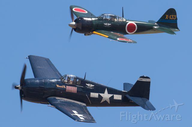 "Experimental 100kts-200kts (N1078Z) - F6F Hellcat ""Minsi III"" and N712Z a A6M3 Zero performing at the Oregon International Air Show."