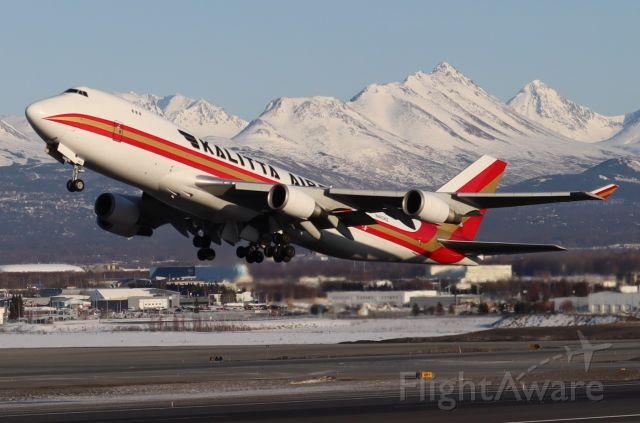 Boeing 747-400 (N403KZ) - Takeoff at sunset, Flattop in view from west side of Runway 15-33 along Pt. Woronzof Rd.