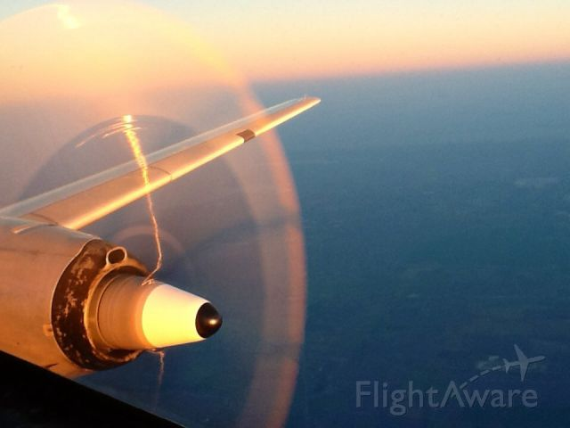 CONVAIR CV-580 (XA-UMI) - Heading back to Laredo from Dayton.<br />A beautiful evening over Houston Area.