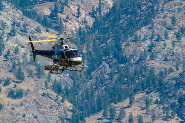 C-GZGN — - Aerospatiale AS-350B dropping supplies in to wildfire firefighters.