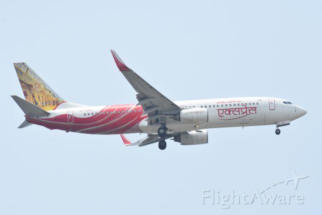 Boeing 737-700 (VT-AXM) - Arrival, Air India Express, RWY 20R, Changi, Singapore. 8 Sep 2019.