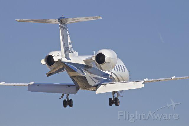 Learjet 60 (N658KS) - On final runway 9 at Aurora Municipal Airport (KARR)