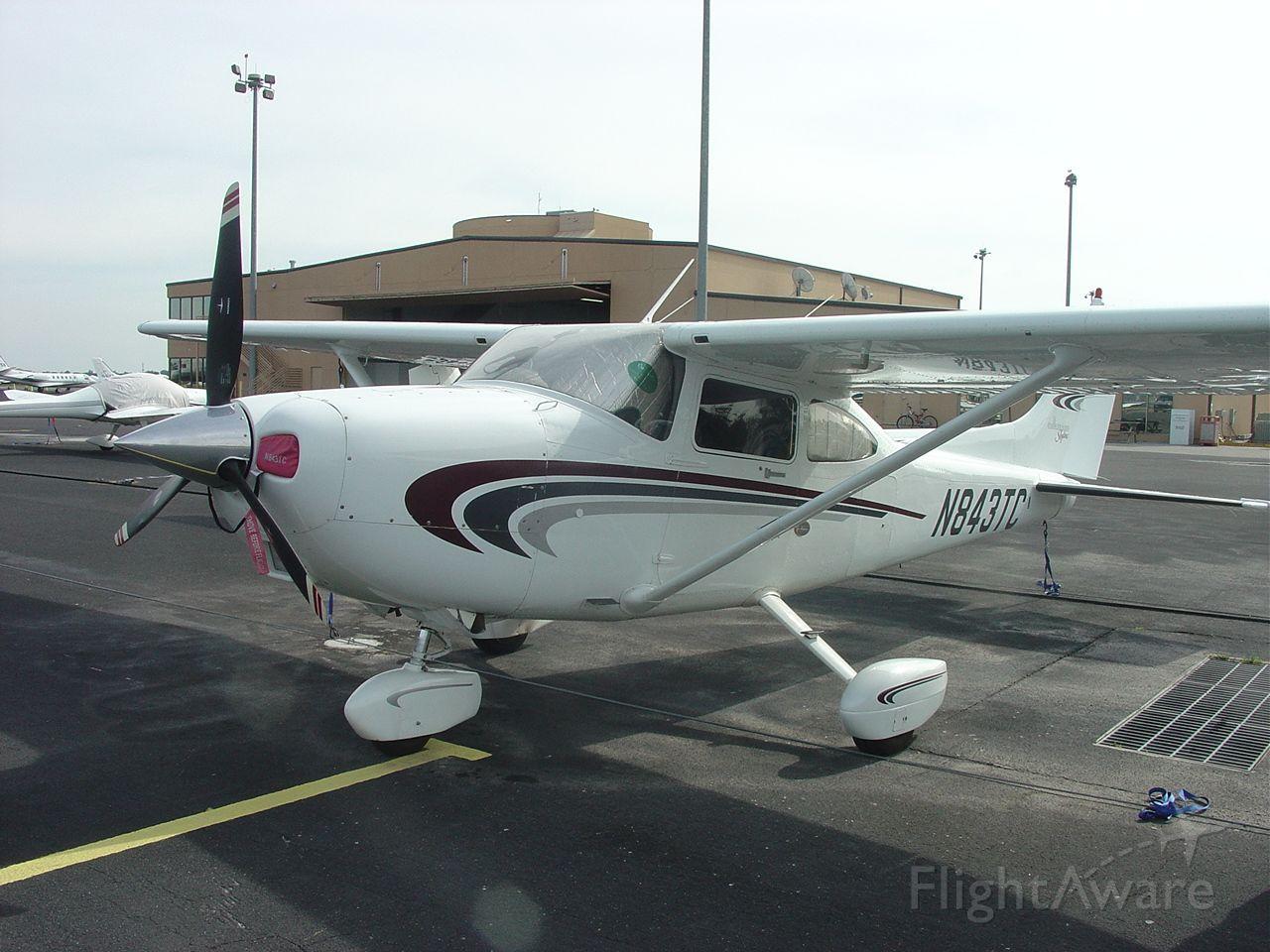 Cessna Skylane (N843TC) - On the ramp at KORL (2003).