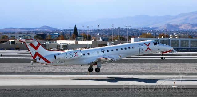 Embraer ERJ-135 (N254JX) - Just off the 34R concrete, JetSuite X's N254JX is on the climb to begin a flight to Bob Hope (KBUR - Burbank, CA).