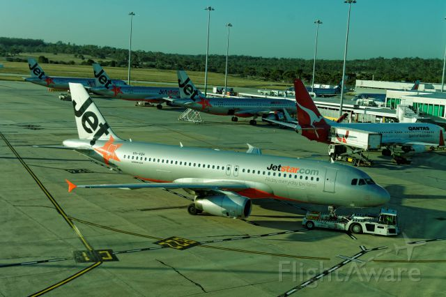 Airbus A320 (VH-VQH) - Pushing back, off soon
