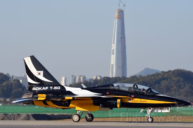 Cessna T-50 Bobcat — - 2015 Seoul International Aerospace & Defense Exhibitionbr /br /ROKAF Black Eagles T-50 with Lotte World Tower under construction