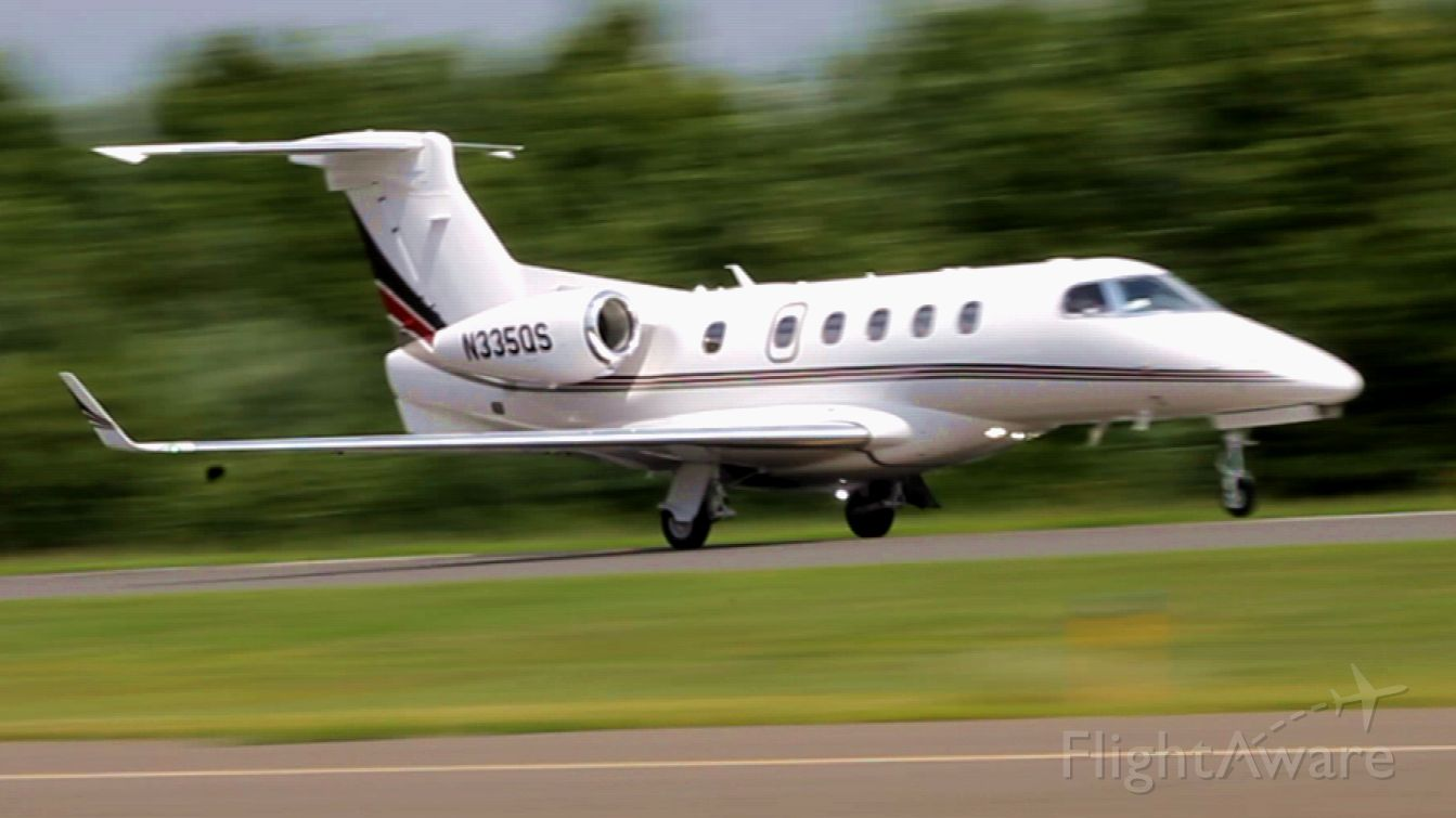 Embraer Phenom 300 (N335QS) - Execjet 335P starting their rotation off runway 20 at Robertson Field