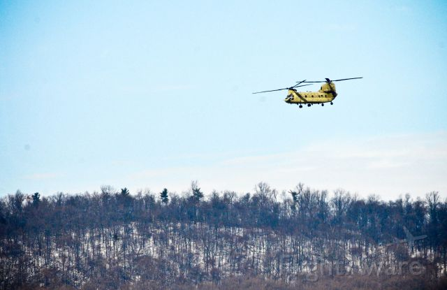 Boeing CH-47 Chinook — - A CH-47 Chinook helicopter, powered by soldiers with Bravo Company, 2-104th General Support Aviation Battalion, 28th Combat Aviation Brigade, flies by a snow-covered mountain at Fort Indiantown Gap, February 11, 2017.