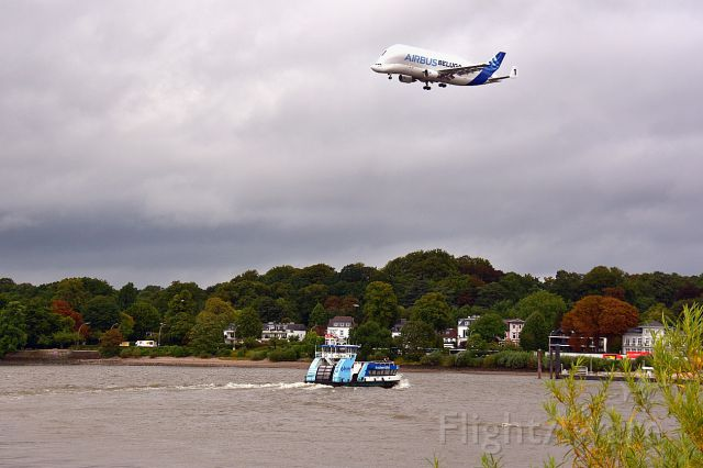 F-GSTA — - If You like aircrafts and vessels, you should go to Hamburg... <br />Here you see the Airbus Beluga No.1 over the Elbe river.  (09/06/2017)