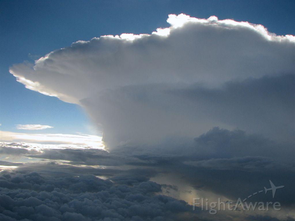— — - Beautiful cumulonimbus cloud while flying to Hokkaido, Japan out of Tokyo Haneda.