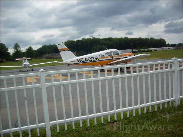 Piper Cherokee (N5402S) - Passing by on a cloudy day to takeoff on runway 5 at the Doylestown Airport in Pennsylvania.