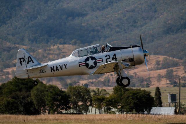 — — - Naval SNJ-5  version of North American Texan departing Watt's Bridge Airfield.