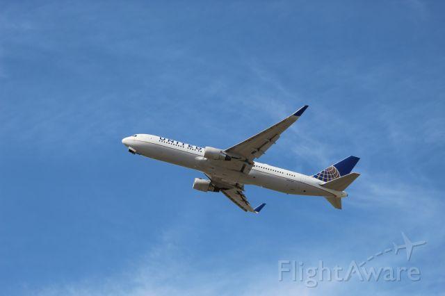 BOEING 767-300 (N665UA) - Takeoff on 28R headed to London Heathrow