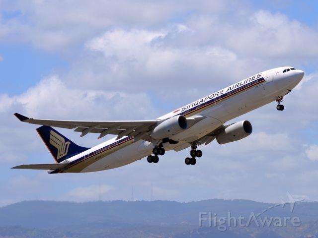 Airbus A330-300 (9V-STQ) - Getting airborne off runway 23 and heading home to Singapore. - Monday 19th Dec. 2011