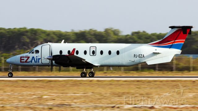 Beechcraft 1900 (PJ-EZA) - Departing during golden hour.