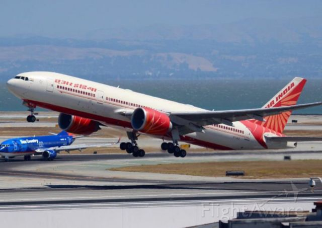 """BOEING 777-200LR (VT-ALG) - Beautiful metal bird VT-ALG """"Kerala"""" departing as AIC174 to Delhi after arrving to SFO as AIC173 with bollywood screen alerts Neha Kakkar and Raftaar onboard for Bay Area Event. (31 August 2016, Throwback picture)"""
