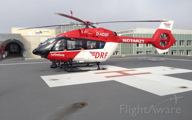 Eurocopter EC-635 (D-HDSF) - EC - H145 , rescue helicopter -(DRF)<br />misses cross ,<br />first landing on new roof base hospital Munich
