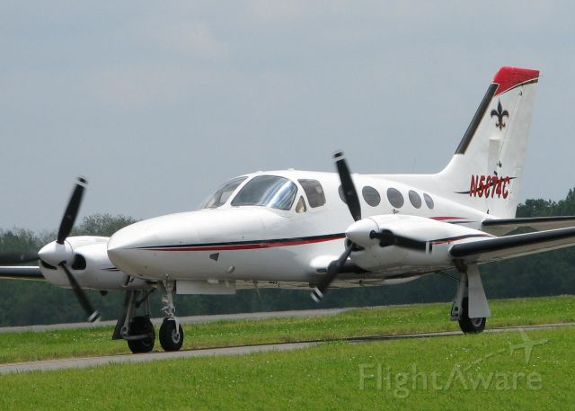 Cessna 421 (N5874C) - Taxiing to runway 14 at the Shreveport Downtown airport. The fleur-de-lis on the tail makes me think that either someone is a N.O. Saints fan or they just like the fleur-de-lis. Nice looking aircraft anyway.