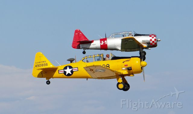 North American T-6 Texan (N36CA) - Two North American T6 Texans (N36CA featured in the back) departing in formation at AirVenture 2015!