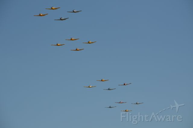 — — - EAA 2011 formation of T-34s.