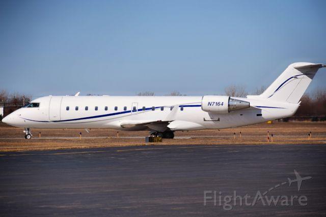 Canadair Regional Jet CRJ-100 (N7164) - Bombardier CRJ-100ER opby Elite Airways (Regional One) departing the FBO ramp at the Buffalo Niagara International Airport for Melbourne, Florida (KMLB) as MNU7164<br /><br />** First Photos of N7164 on FlightAware **