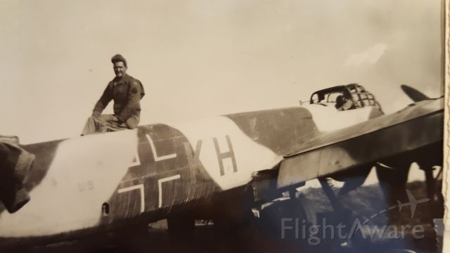 — — - Downed Junkers JU-88. Photo somewhere in the European Theater 1944-1945. My father sits atop.
