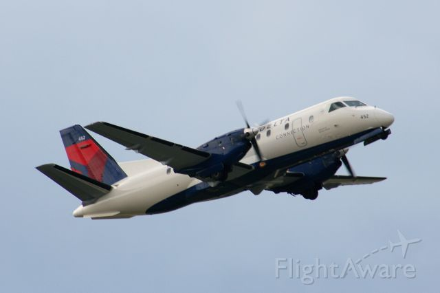 Saab 340 (N452XJ) - A Mesaba Saab 340 painted in the new Delta colors climbs out of KFSM.