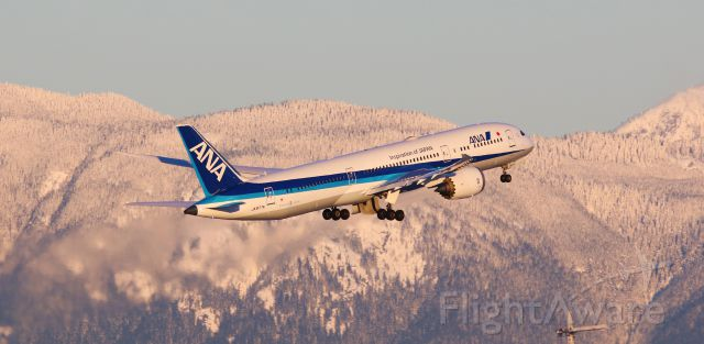 Boeing 787-9 Dreamliner (JA877A) - ANA Boeing 787-9 Dreamliner JA877A departure from YVR to HND with a snowy mountain background
