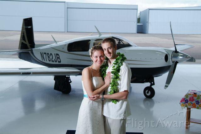 Mooney M-20 Turbo — - Wedding photos in front of N782JB. Thanks again Jon for letting us borrow the plane.