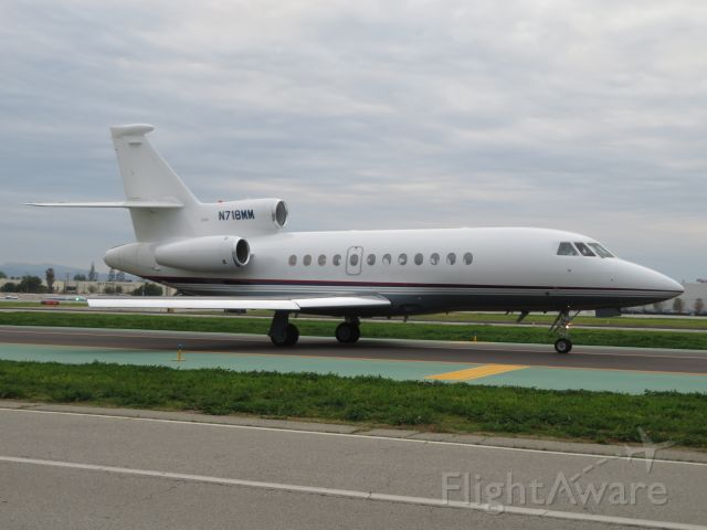 Dassault Falcon 900 (N718MM) - This Dassault Falcon 900 taxis to Runway 16R for San Jose Del Cabo, Mexico.