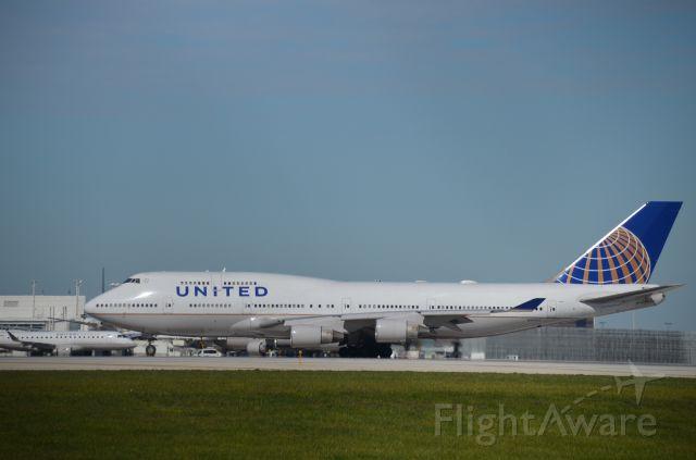 "Boeing 747-200 (N179UA) - A ""Whale"" preparing to depart on Rnwy 28C. Photographed from behind Gate Gormet."